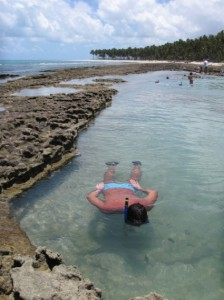 Man snorkeling off the shore of Maceio, capital of Alagoas