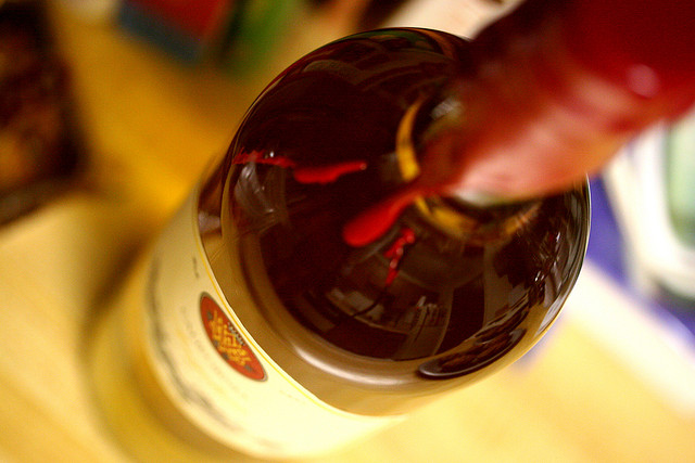 Close-up view of the neck of a wine bottle.