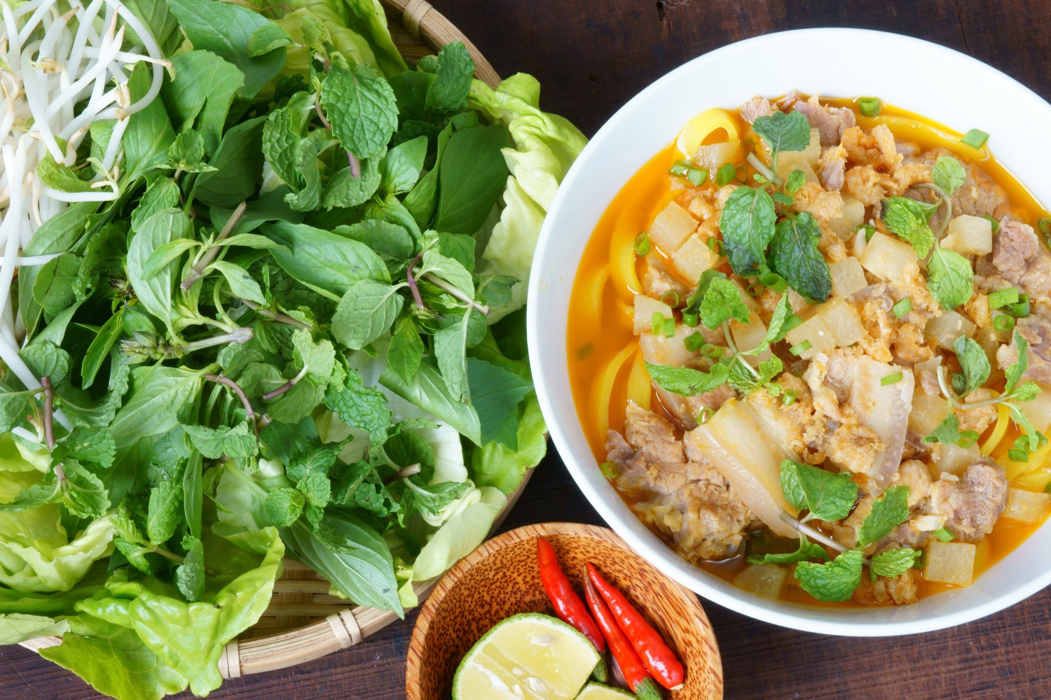 Bowl of mi quang with salad and other ingredients