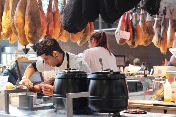 Hams hanging at Markthal food market, Rotterdam