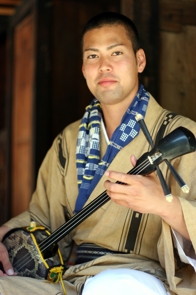 sanshin player at Beginning a dance at Ryukyu Mura