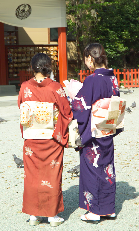 Girls read their fortunes at Tsurugaoka Hachim...