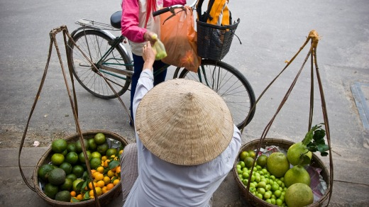 A street vendor sells fruit in Ho Chi Minh City.
