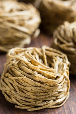 Tajarin or Tagliolini, made with fresh eggs and buckwheat flour, a specialty pasta from Piedmont.