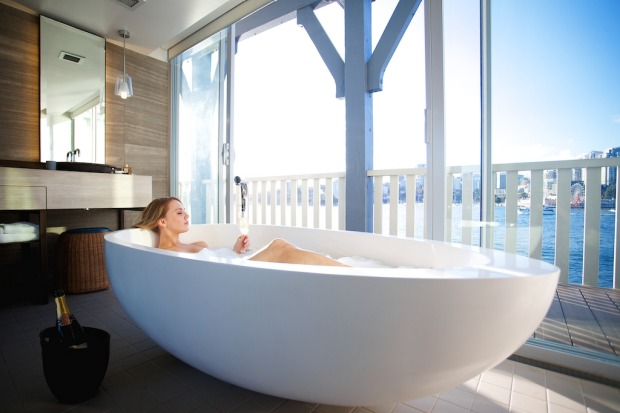 Giving ferry commuters a thrill: bathe with the blinds open in the Harbour View Balcony Suite.