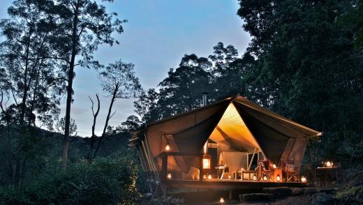 A luxury tent at sunset, Nightfall Wilderness Camp.